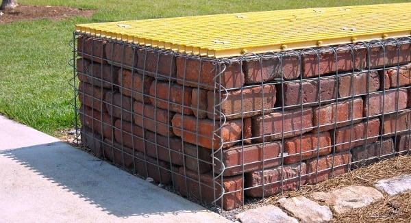 brick stacked in gabion basket