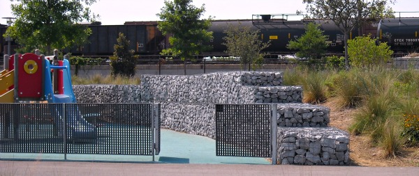 playground surrounded by gabions