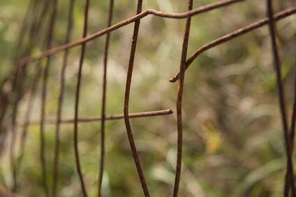 poor quality fence rusted broken