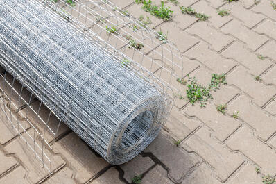 Galv After mesh fence on paving stones