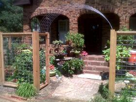fence gate entry to brick home