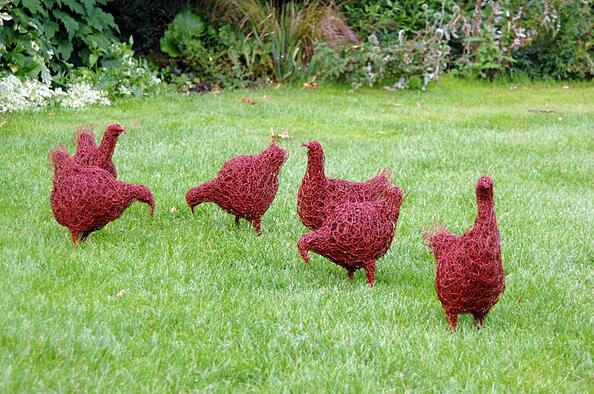 wire sculpture of chickens on lawn
